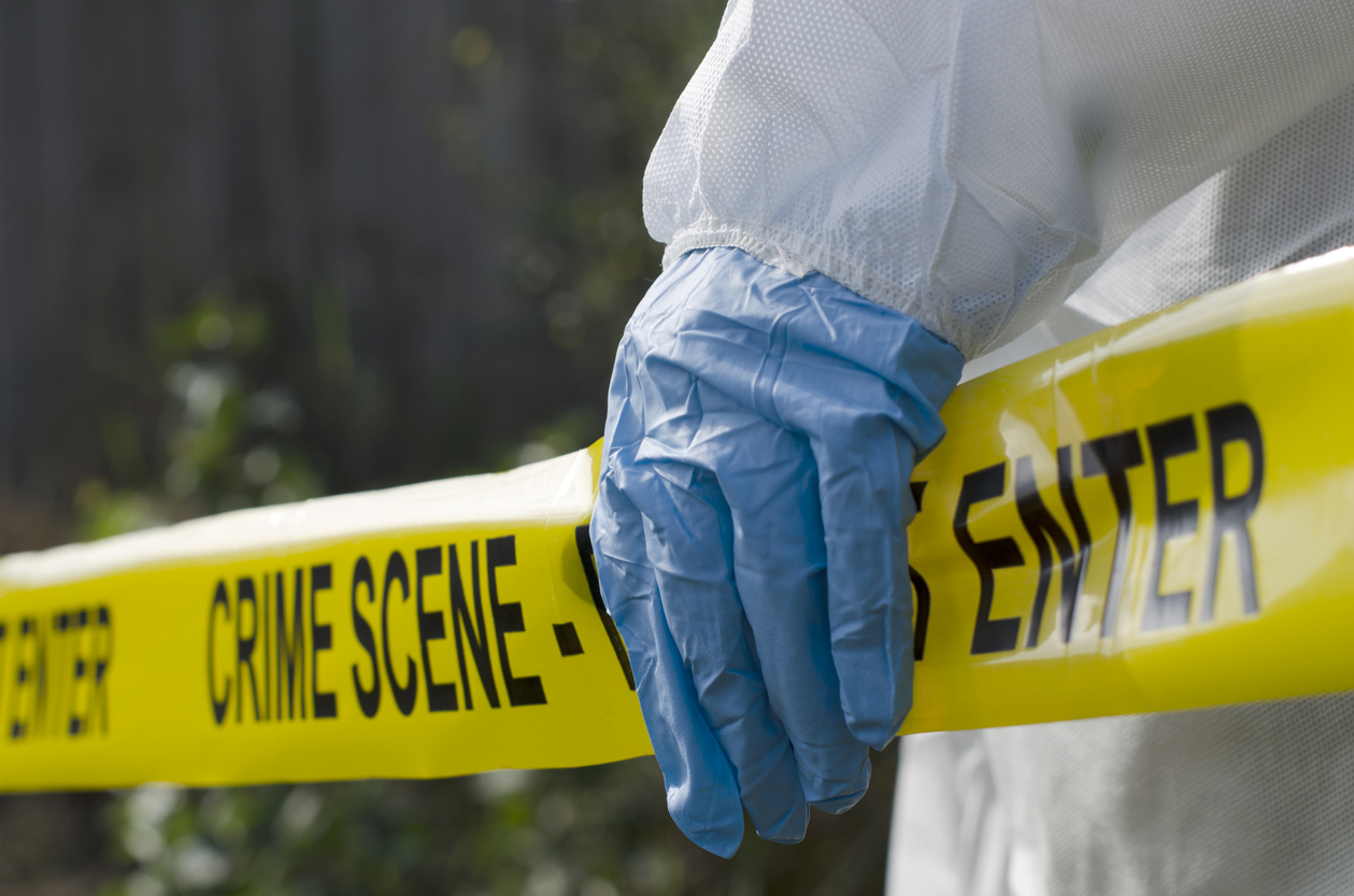 Forensic investigator working at a crime scene
